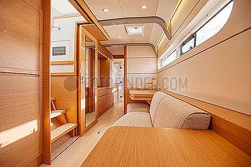 Inside the starboard hull of a catamaran cruising on the Garonne river