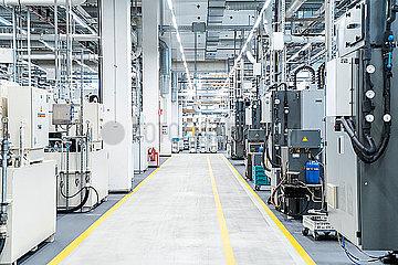 Footpath between industrial machinery in modern factory  Stuttgart  Germany