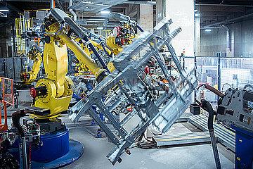 Robots spot welding car parts in car factory
