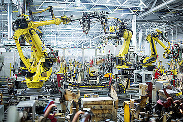 Industrial robots in a car factory