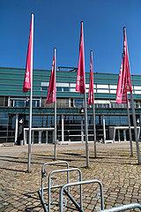 Deutschland  Bremen - Haengende Fahnen der Messe Bremen vor der Halle 4 an der Buergerweide