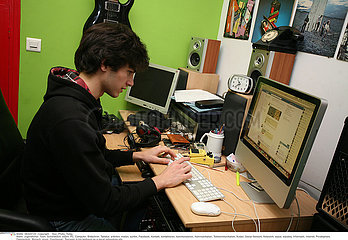 TEENAGER AT A COMPUTER