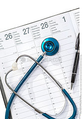 Doctor appointment plan concept.Stethoscope Notebook Notes Schedule