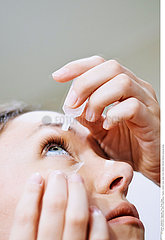 WOMAN USING EYE LOTION Studio