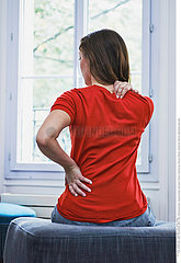 WOMAN WITH BACK PAIN Studio