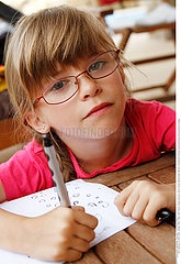CHILD DOING HOMEWORK Studio
