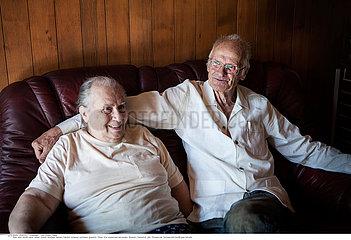 ELDERLY COUPLE INDOORS