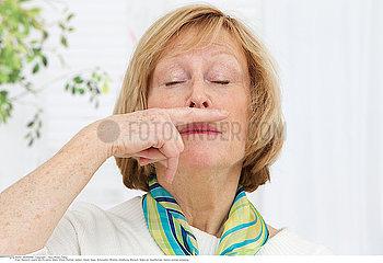 ELDERLY PERSON SNEEZING