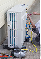 Heat Pump. plumber at work installing a circulation heat pump energy saving