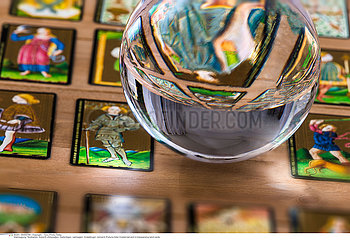 Fortune teller Crystal ball and in transparency tarot cards background .