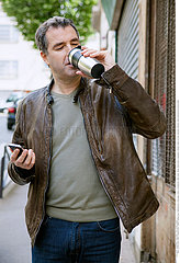 MAN WITH HOT DRINK