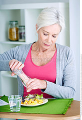 ELDERLY PEOPLE EATING A MEAL