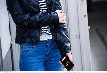 ADOLESCENT WITH PHONE