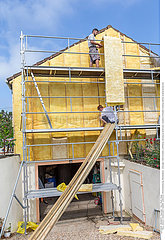 House insulation. scaffolding mineral wool  cladding of buildings  resource conservation