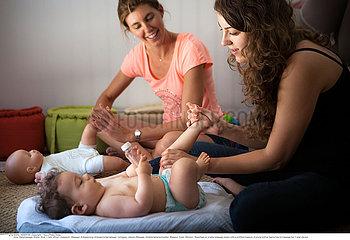 INFANT BEING MASSAGED