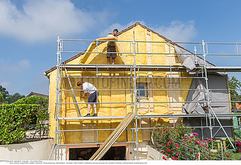 House insulation. scaffolding mineral wool  composite panels cladding of buildings  resource conservation