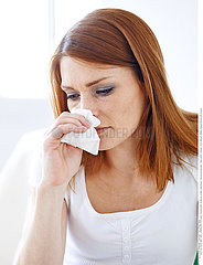 WOMAN WITH NOSEBLEED