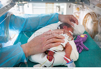 A nursery nurse takes care of a premature baby. Hospital. Aix en Provence.