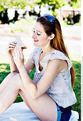WOMAN EATING A SANDWICH