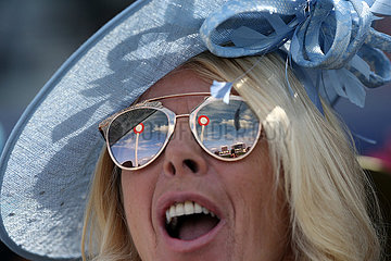 Royal Ascot  The winning post mirrores in the sunglasses of a woman with hat