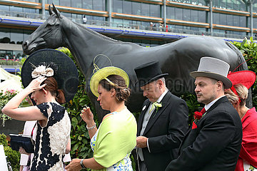 Royal Ascot  Fashion  women with hats and men with top hats on Ladies Day at the racecourse. Ascot racecourse
