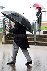 Royal Ascot  Man at the racecourse under his umbrella