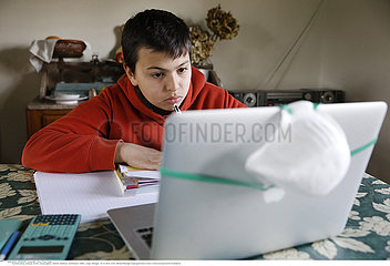 Teenager studying at home in Eure  France during COVID-19 epidemic