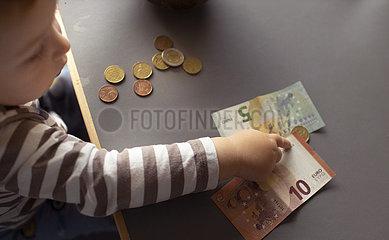 Kind und Geld