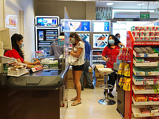 Dubai  UAE  September 2020- Customer and staff wearing masks in the supermarket.