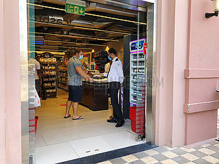 Dubai  UAE  September 2020- Mandatory temperature checks on entry to the shop.