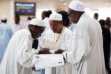 Dubai  local men betting at the racecourse