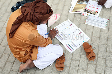 Dubai  local man betting at the racecourse