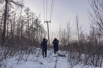 CHINA-HEILONGJIANG-mohe-WINTER-Stromversorgung (CN)