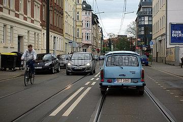 Magdeburg  Deutschland  blauer Trabant faehrt auf einer Strasse