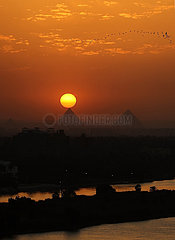 EGYPT-GIZA PYRAMIDS-SUNSET