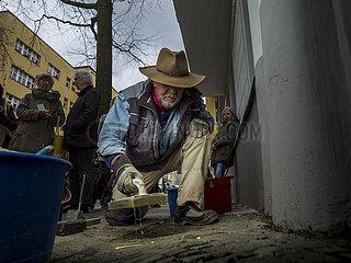 German Artist Gunter Demnig lays 'Stolpersteine'