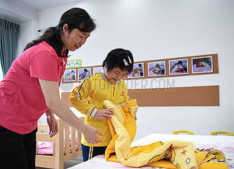CHINA-GUANGDONG-DIENST HOUSE- 'Angel MOMS' (CN) CHINA-GUANGDONG-DIENST HOUSE- 'Angel MOMS' (CN)