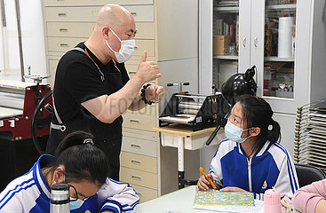 CHINA-BEIJING-HEARING IMPAIRED-ART TEACHER (CN)