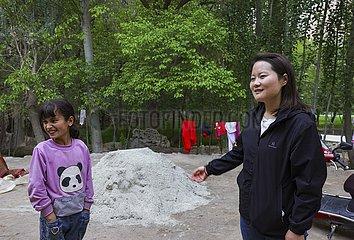 (FOCUS) CHINA-XINJIANG-GENERATION Z-Dorflehrer (CN)