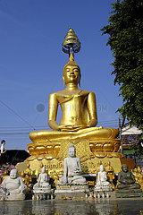 seated golden Buddha with small Buddhas  Wat Manee Praison  Mae Sot  Thailand  Asia