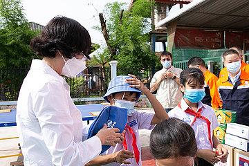 Laos-Vientiane-China-Companies-Spende